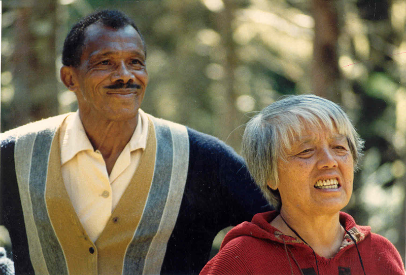 headshot of James and Grace Lee Boggs outdoors, with trees in the background